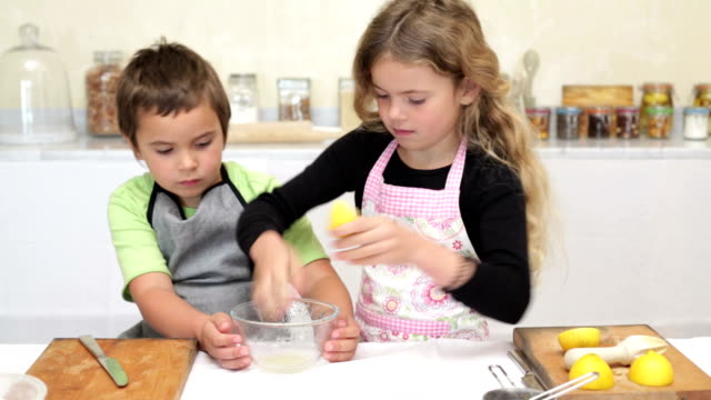 Little girl and her brother baking video