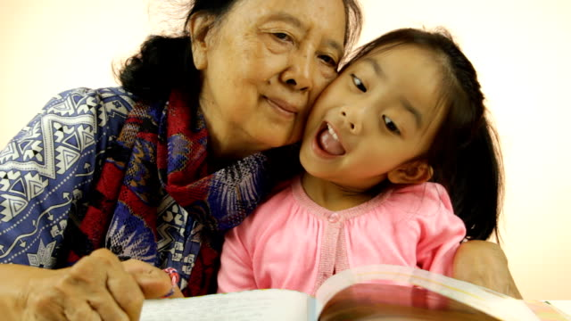 Little girl and her grandma showing okay sign video