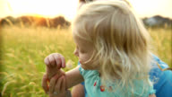 Little girl and mother in field video