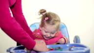 Little girl and mother play with plasticine video
