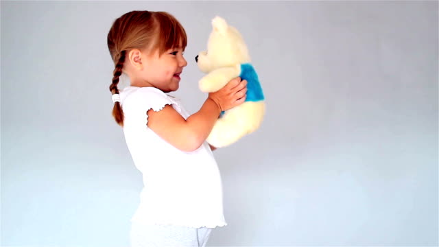 Little girl and toy bear video