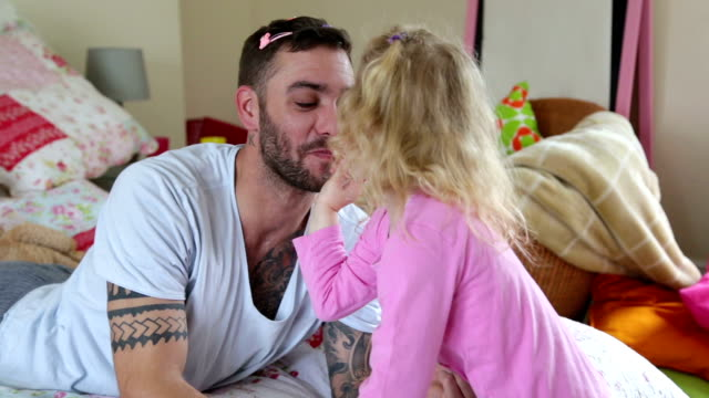 Little Girl Applying Make-up to her Daddy. video