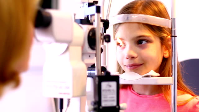 Little girl at optician's office. video