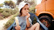 Little Girl At The Beach Eating Ice Cream and Get Messy. video