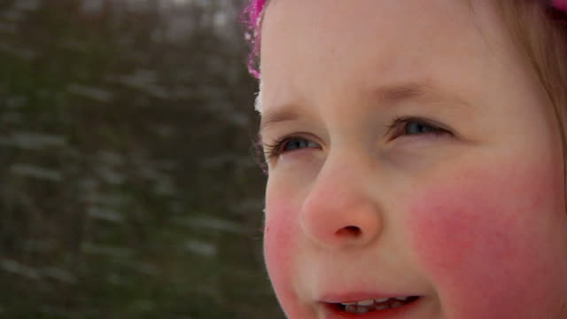 SLOW MOTION: Little girl blinking into the snow video