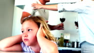 Little girl blocking out noise from parents fighting video
