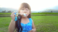 Little Girl Blowing Bubbles video