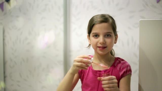 Little girl blows soap bubbles slow motion video