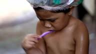 Little girl brushing teeth video