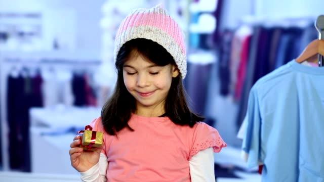 Little girl choosing a bigger gift video