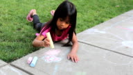 Little Girl Creating Sidewalk Art Using Chalk video