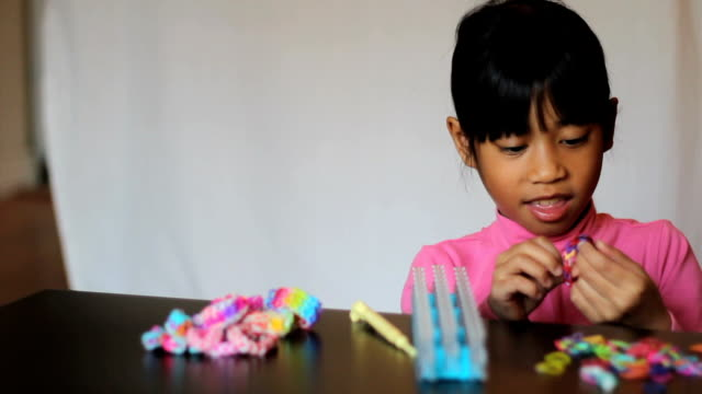 Little Girl Displays Color New Handmade Bracelet video