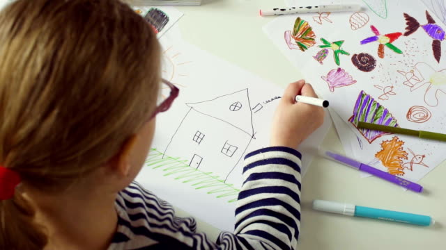 Little Girl Drawing a house video