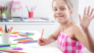 Little girl drawing a picture on the table. video