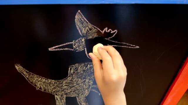 Little girl draws on easel video