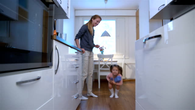 Little Girl Drops The Trash Into Kitchen Recycling Bin. Dolly video