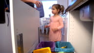 Little Girl Drops The Trash Into Kitchen Recycling Bin video