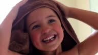 Little Girl Drying Hair With Towel After Bath video