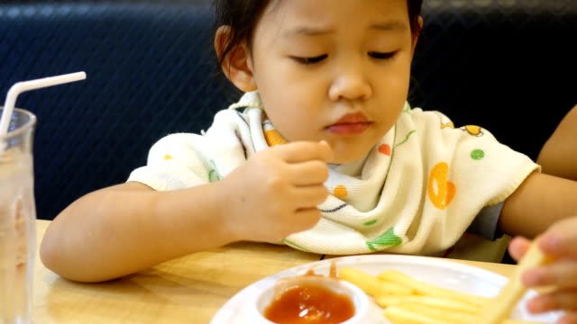 little girl eating a french fries video