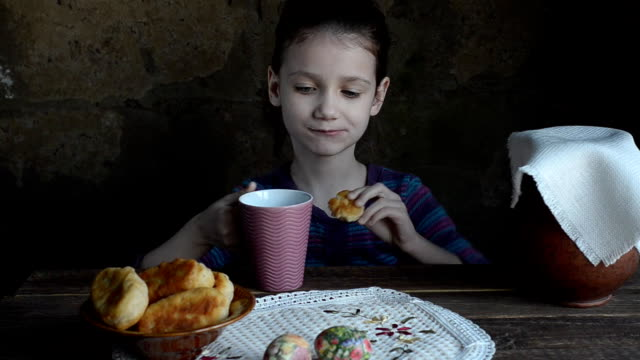 Little girl eating fried pies and milk video