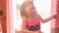 A little girl eating milk and cookies at the kitchen counter video