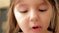 Little girl eating strawberry video