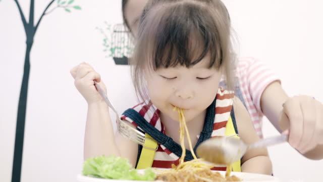 Little Girl Eating Yummy spaghetti. video