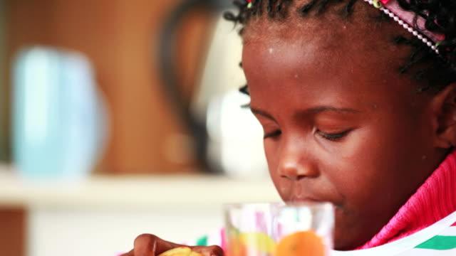 Little girl eats breakfast video