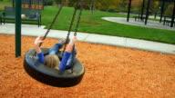 Little girl falls under tire swing video