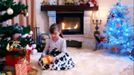 Little girl found a gift under the Christmas tree video