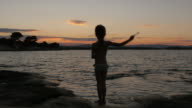 Little Girl Gesturing At a Beach in Sunset video