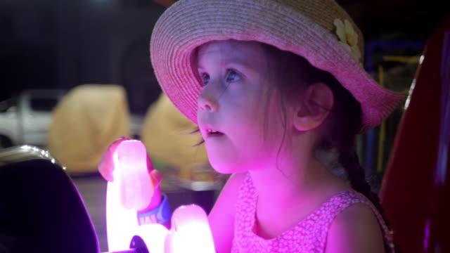 Little Girl Having Fun At The Amusement Park. video