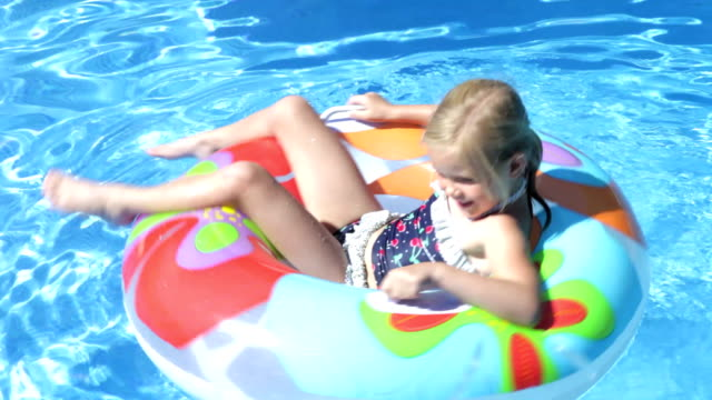 Little Girl Having Fun In Swimming Pool video