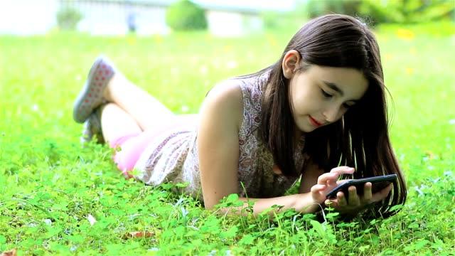 Little girl having fun on smartphone video