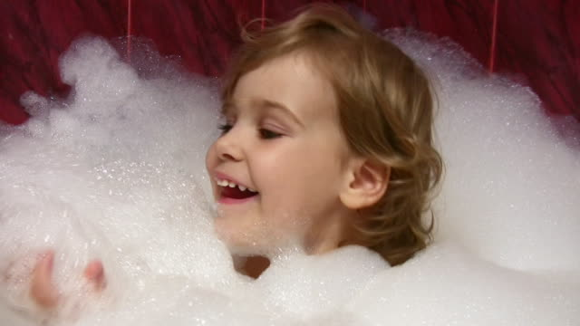 Little girl in bath with foam video