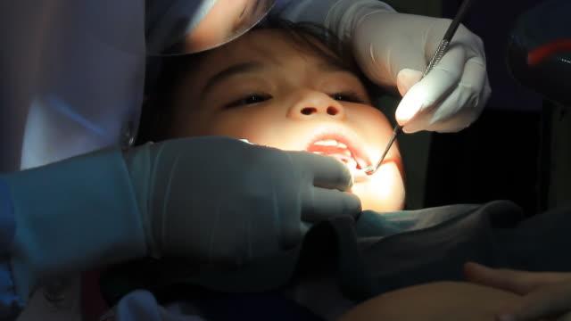 Little girl in dentist office video