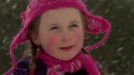 Little girl in snowfall video