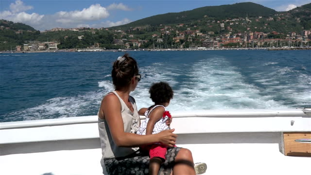 Little girl in the excursion boat in the sea video