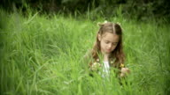 Little girl in the grass. video
