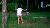 Little girl in underwear playing with a rope swing video