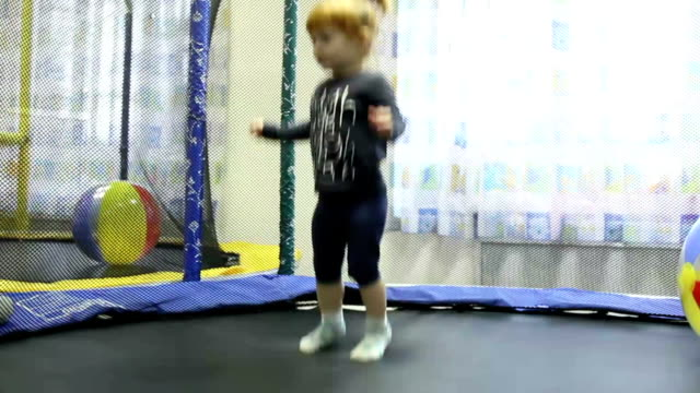 A little girl jumping on the trampoline in playground video