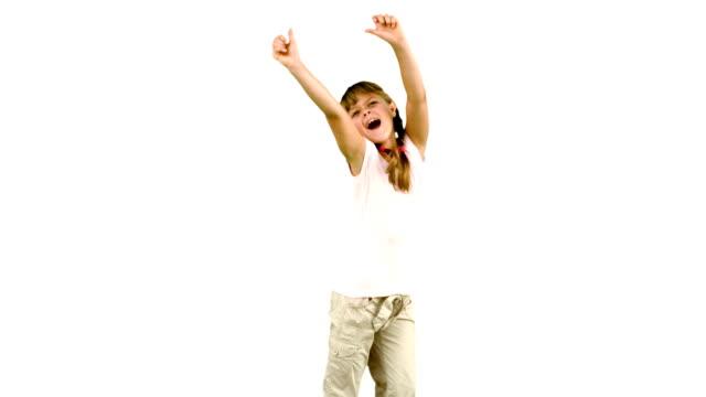 Little girl jumping on white background video
