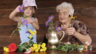 Little Girl Learn How To Arrange Flowers In A Vase. Real People, Rural Scene. video