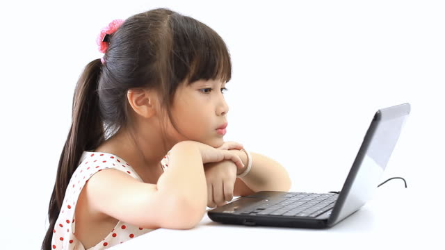 Little girl learning computer video