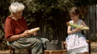 Little Girl Learns From Her Grandmother How to Peel off The Corn.. Real People, Rural Scene, User Generated Content. video