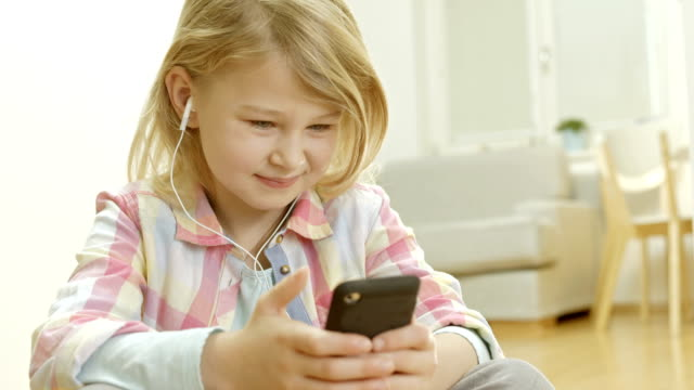 Little Girl Listening To The Music video