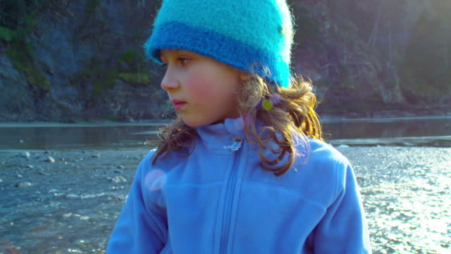 Little girl looks around at river video