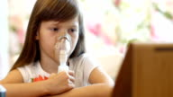 little girl making inhalation video