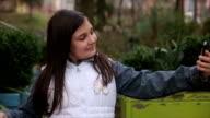 Little girl making selfie on smart phone video