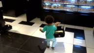 Little girl of mixed race in the perfume shop is choosing creams video